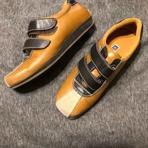 Flat brown and  dark brown bowling style shoe